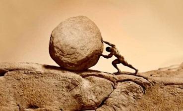 man-pushing-rock-up-hill-ok-to-use